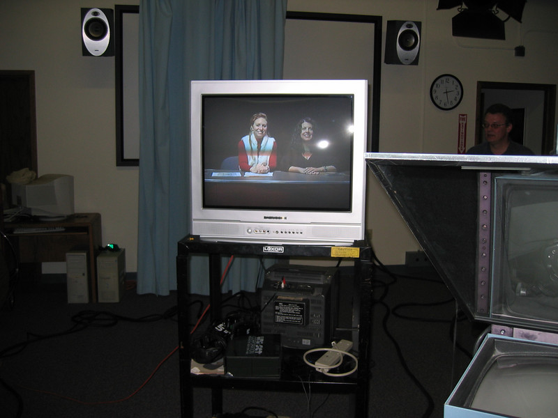 Looking at the monitors during the taping. (Time Warner show)