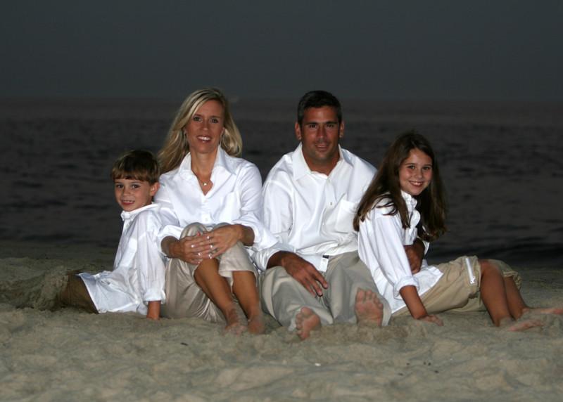 family sitting in dark 5x7