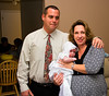 Godmother and aunt Kelly and husband with Leah.  Leah eyes the cameraman suspiciously . . . with good reason.