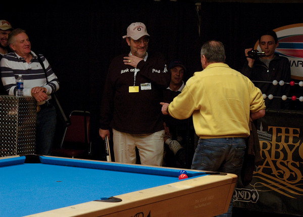 ...discussing Efren's shot selection with the Beard
