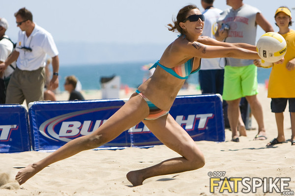 Michelle More lunges for a serve