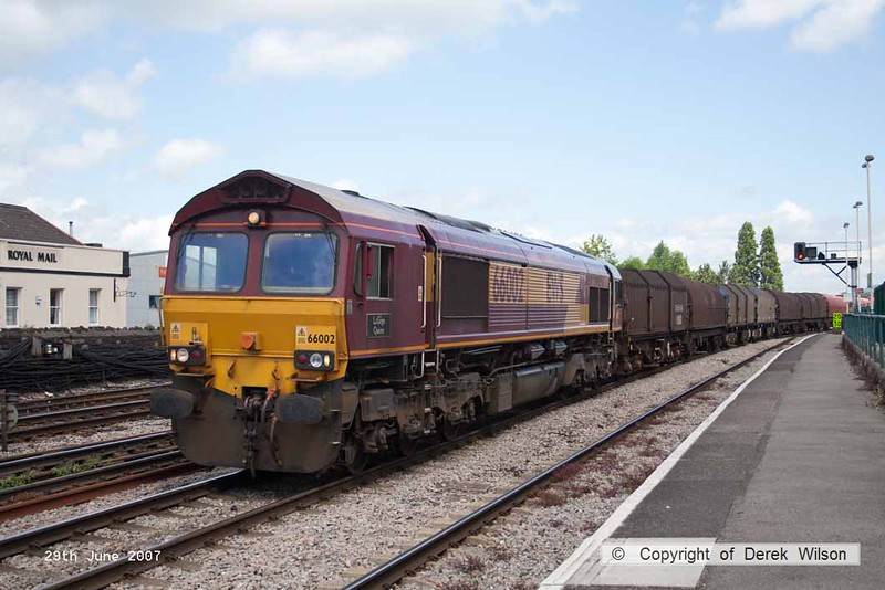 070629-031     EWS class 66/0 no 66002 Lafarge Quorn is seen passing through Newport with a unidentified 'steel' train.