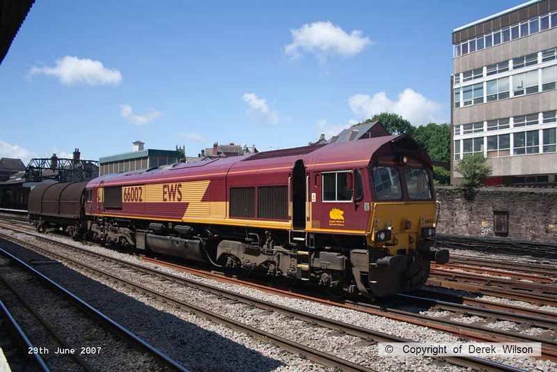 070629-015     EWS class 66/0 no 66002 Lafarge Quorn is seen passing through Newport, Gwent with just one covered steel carrying wagon.