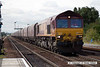 070831-028     EWS class 66/0 no 66058 passing through Barnetby, powering train 4C73 Scunthorpe to Immingham loaded coal hoppers.