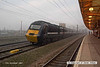 071215-005     A National Express East Coast HST, 'top and tail' with  43077 & 43318 speeds past a dreary Retford with the 07.44 Harrogate to London King's Cross.