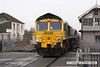 071214-013     Freightliner class 66/5 no 66545 is seen passing through Worksop with a rake of empty coal hoppers, working unknown.