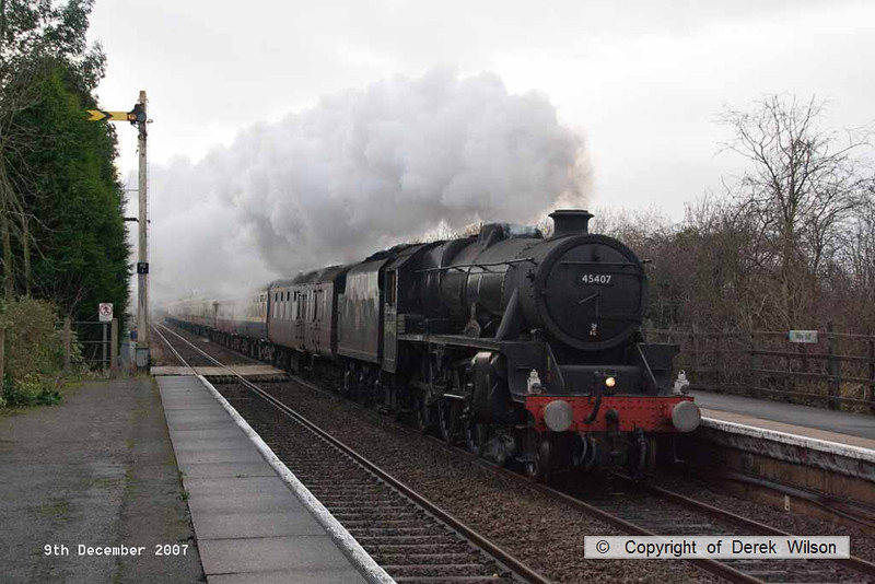 071209-001     LMS 'black five' 5MT 4-6-0 no 45407 The Lancashire Fusilier thunders through a very dull Rolleston, near Newark, powering the Railway Touring Company's Lincoln Christmas market special, train 1Z70 the 09.20 York to Lincoln. This was originally advertised to be hauled by 71000 but was then changed to 45407 plus 76079, due to the latter being unavailable (out of gauge?) it ran with 45407, plus class 47 no 47847 at the rear.
