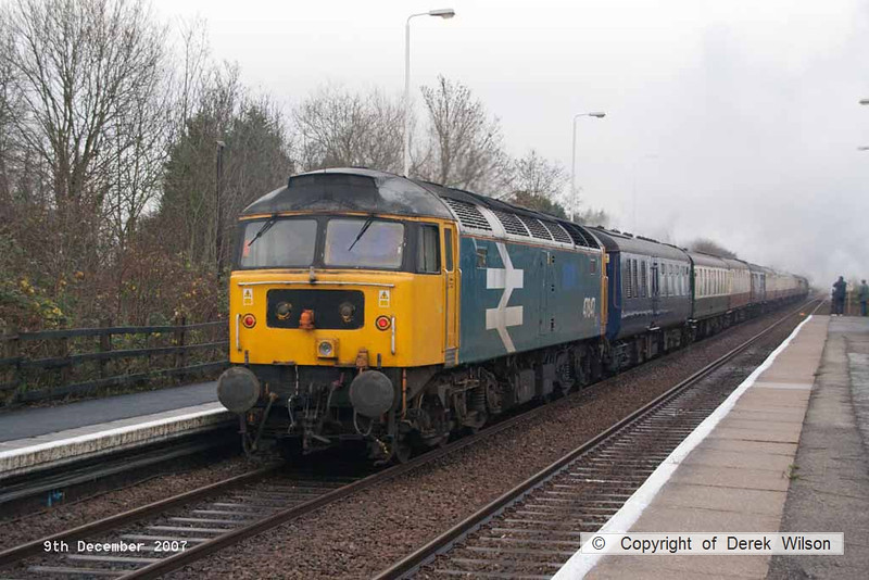 071209-002     Large logo, blue class 47/8 no 47847 is captured passing Rolleston, at the rear of the Railway Touring Company's Lincoln Christmas market special, train 1Z70 the 09.20 York to Lincoln. LMS 5MT 4-6-0 no 45407 The Lancashire Fusilier can be seen in the distance, at the front of the train.