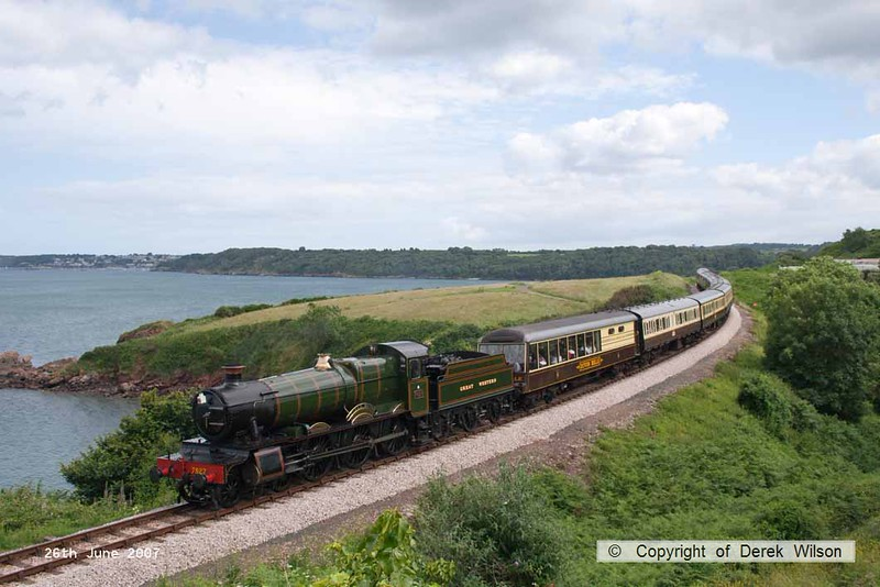 070626-004     Great Western Railway 'Manor' 4-6-0 no 7927 Lydham Manor is seen passing Waterside Caravan Park with a Kingswear to Paignton service.