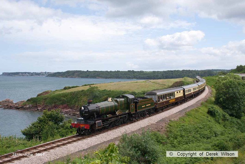 070626-003     Great Western Railway 'Manor' 4-6-0 no 7927 Lydham Manor is seen passing Waterside Caravan Park with a Kingswear to Paignton service.