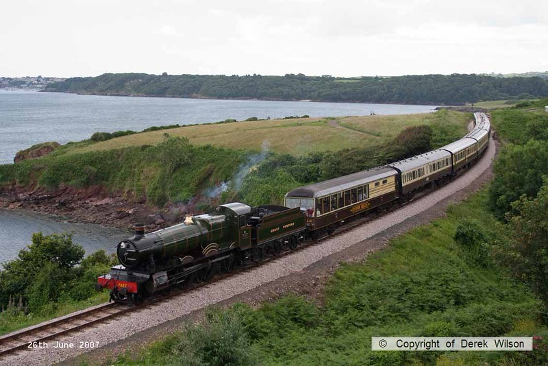 070626-001     Great Western Railway 'Manor' 4-6-0 no 7927 Lydham Manor is seen passing Waterside Caravan Park with a Kingswear to Paignton service.