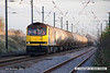 071102-021     EWS class 60 no 60014 Alexander Fleming is seen heading along the down-main as it passes Barnby Lane level crossing at Claypole, powering 6E82, the 12.16 Rectory Junction to Lindsey oil refinery, formed of empty (fuel-oil) bogie tanks.