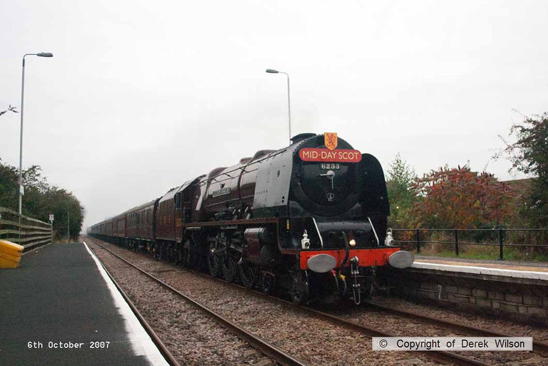 071006-003     LMS Coronation class 4-6-2 no 6233 Duchess of Sutherland passes a dreary Aslockton, powering railtour 1Z64 Derby  to London King's Cross.