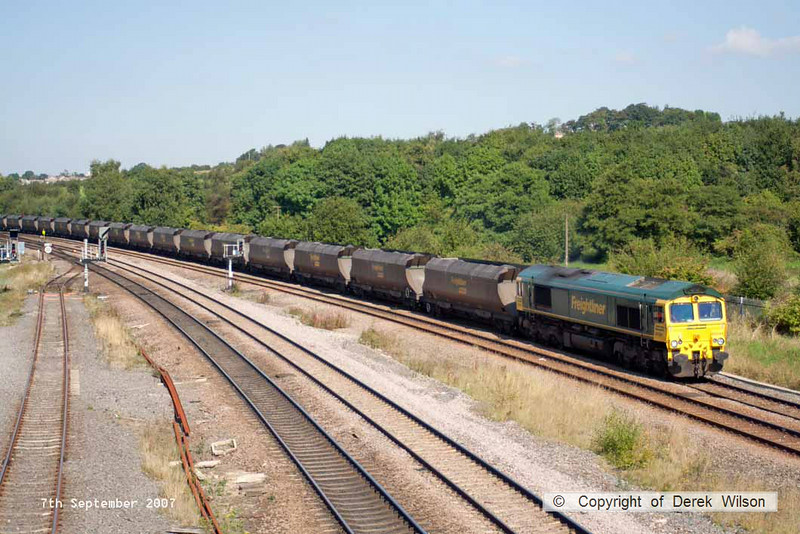 070907-001     Freightliner class 66/5 no 66544 takes the Erawash line at Clay Cross, hauling a rake of loaded coal hoppers, working not known.