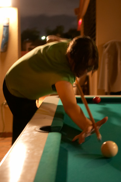 Everyone looks cool when they're playing pool