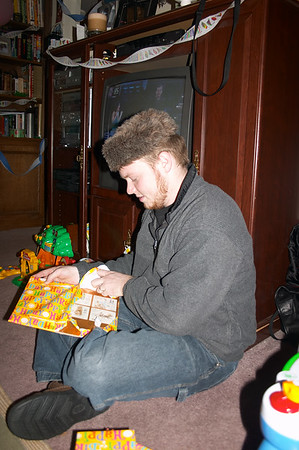 Matt opens presents while muttering to himself in a Russian accent