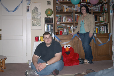 John and Jackie hang out where the real action is: By the Elmo chair