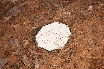 A stone marker with a message encoded in Rot-13