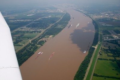 Barges ply the river near Baton Rouge