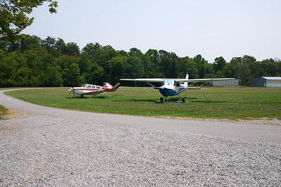 Planes parked at the edges of the grass strip at TN98 (SkyRanch)