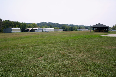 The grass strip and hangars