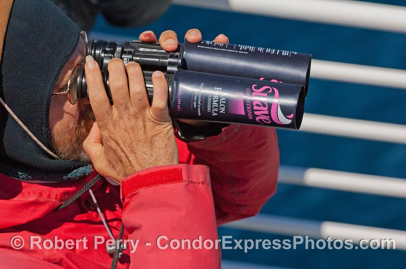 man with binoculars shampoo jars 2007 09-08 So Calif Bight-001