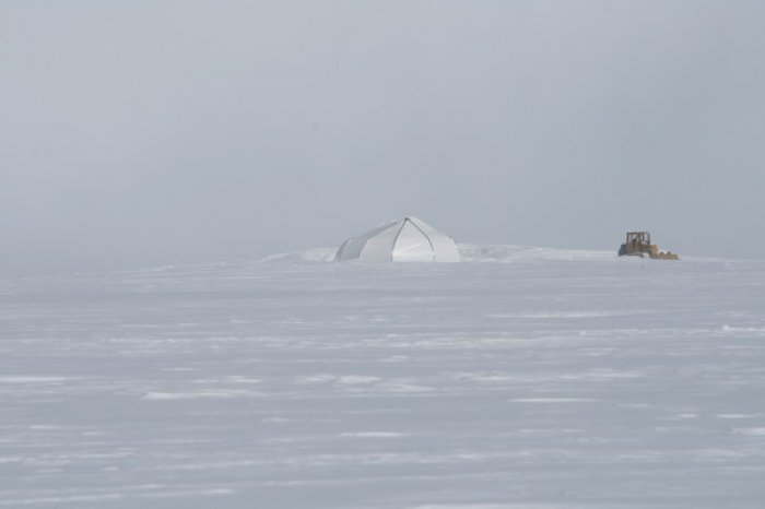 The white weatherport that contained vehicles.