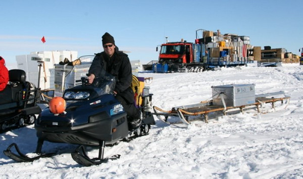 Lars is driving around, setting up sticks to measure the iceflow.