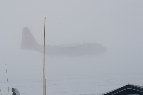 C-130 in the storm<br /> A view of the airplane from the Dome when the storm peaked.