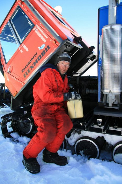 Sverrir doing maintenance on a tracked vehicle