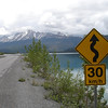 the Alaska Highway as it winds next to Muncho Lake in northern British Columbia