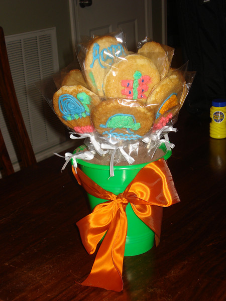 """I made lollipop sugar cookies for Aaron's classmates.  They are sitting in chocolate graham cracker """"dirt"""""""