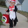"""Aaron running down the driveway of his first """"trick or treat"""" house"""