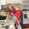 Aaron helps mom make blueberry pancakes for Christmas breakfast.