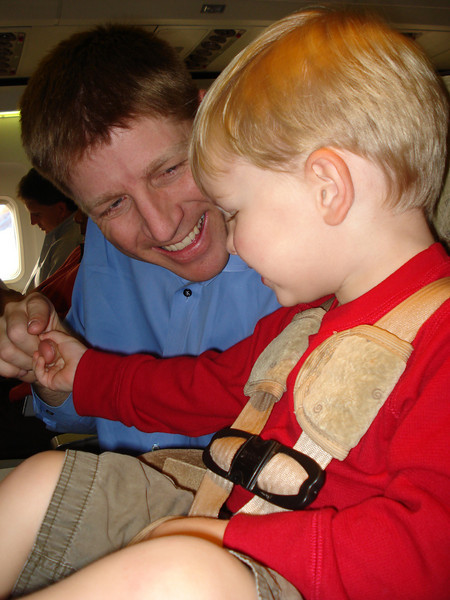 Hold Daddy's finger as the plane takes off.