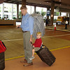 Andy carries the precious luggage