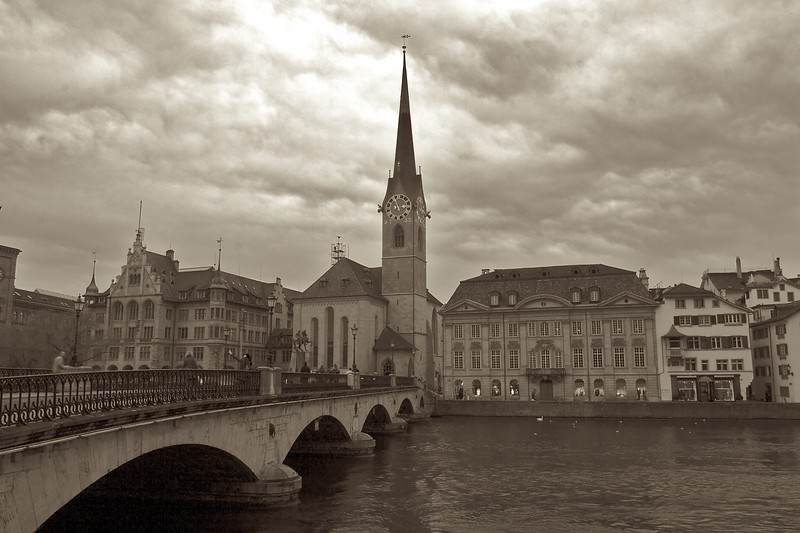 Grey day in Zurich • The Münster-Brucke in Zurich leads from the Grossmünster (behind me) on the West side of the River Limmat to the Fraumuunster, on the East bank.