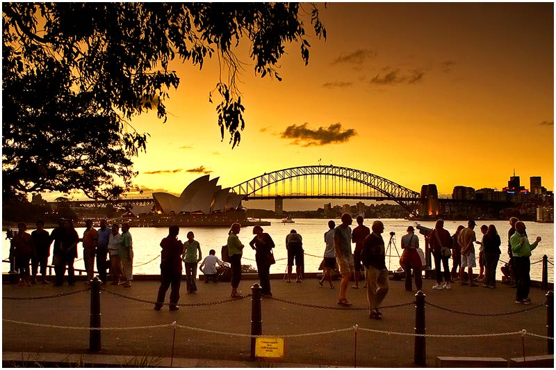 Mrs. Macquaries Point, Monday 9th April 2007.<br /> <br /> People gather to watch the sunset over the opera house and harbour bridge.<br /> <br /> <br /> EXIF DATA<br /> Canon 1D Mk II. EF 17-35mm f/2.8L@24mm 1/80 f/4 ISO 500.