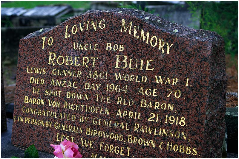 "Brooklyn Cemetery, Wednesday 25th April 2007.  No one is sure who actually shot down The Red Baron in April 1918 but Robert Buie claims to have done so and even has it etched on his headstone. He died 43 years ago on this day, <a href=""http://www.dva.gov.au/commem/commac/studies/anzacsk/aday1.htm"" target=""_blank""><strong><em>Anzac Day</em></strong></a> , the day when Australia commemorates the anniversary of the tragic Gallipoli landings of 1915. You can read about Robert Buie <a href=""http://www.theaustralian.news.com.au/story/0,20867,21514532-31477,00.html"" target=""_blank""><strong><em>here</em></strong></a>.  View location on <a href=""http://maps.google.com/maps/ms?ie=UTF8&hl=en&om=1&z=14&ll=-33.848891,151.195393&spn=0.0489,0.079651&t=h&msid=107047001763101043024.0000011220d1704ca90a2&msa=0"" target=""_blank""><strong><em>Google Maps</em></strong></a>.    EXIF DATA  Canon 1D Mk II. EF 24-70mm f/2.8L@45mm 1/50 f/4.5 ISO 200."