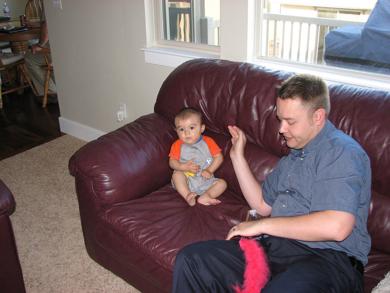 Dustin is playing with baby Scott.