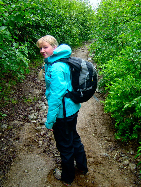 Kaija Klauder turns to look back as we head up an ancient mining road to get above the alders.