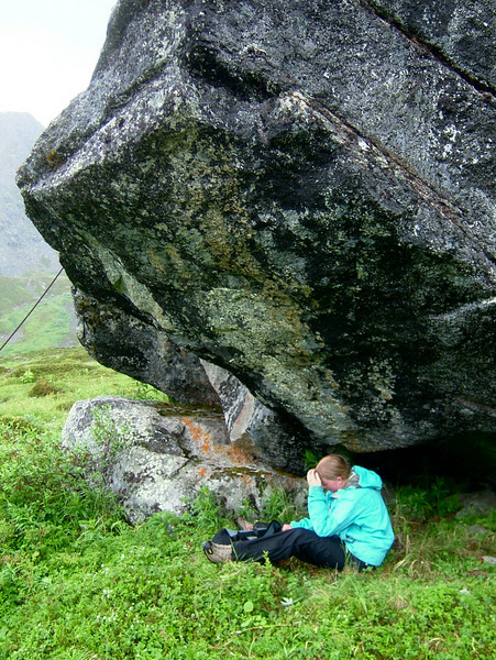 Rain in Hatchers is nothing exceptional.  Kaija takes shelter under a boulder for a bit of a snack.