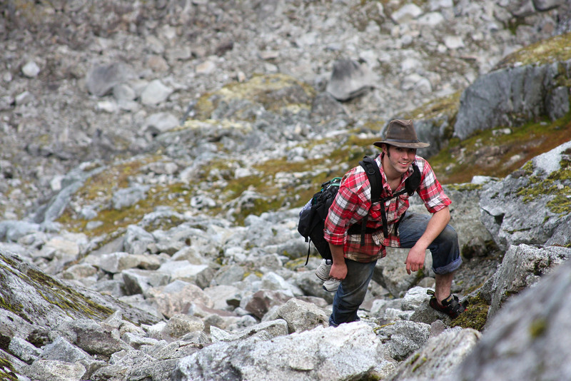 The boulders fall away as we make our way to the top of a ridge.  Richard stops for a photo op.