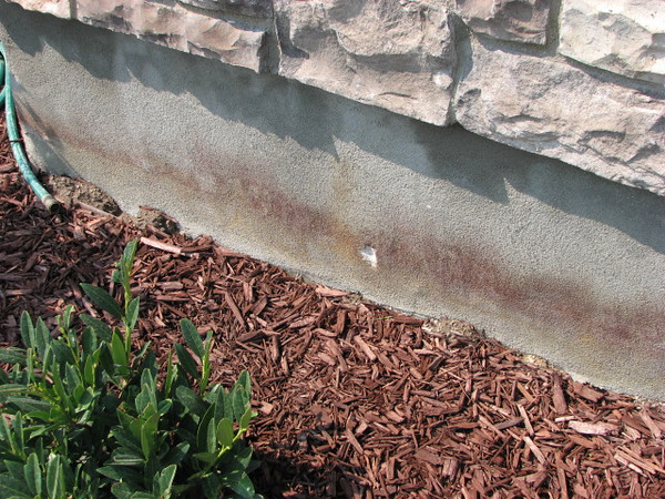 """We noticed the """"knick"""" in the front of our house a few days ago...and wondered how it happened...is the sprinklers hitting the front of the house wierd?"""