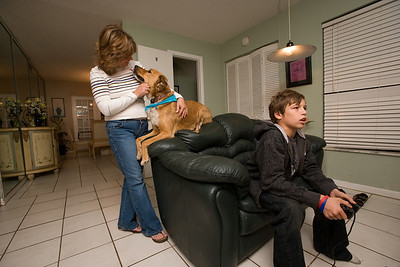 Susan, Thad and Trae Landrith with dog Max