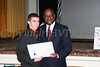 Evan Pritchard receives his scholarship from Rev Jefferson during the 2007 Tuskegee Airmen Tuition Assistance dinner.