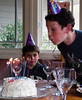 Sammy blowing out the candles.