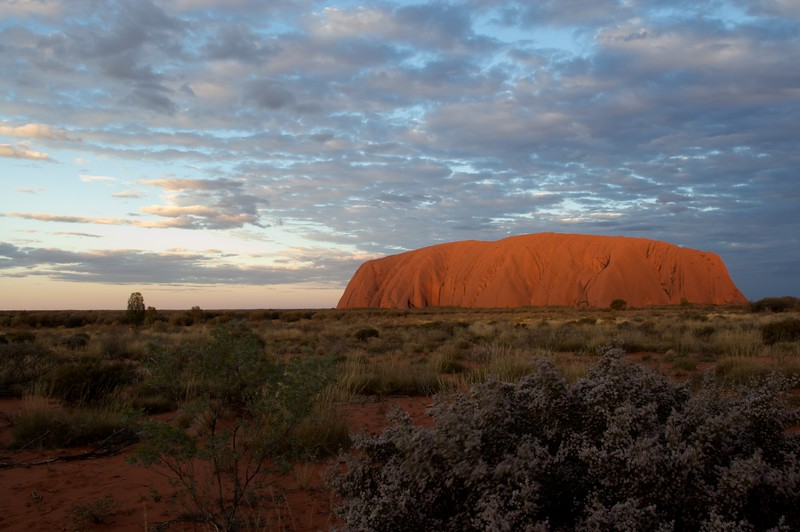 The changing face of Ayers' Rock 11 • It is frequently said that Ayers'Rock changes colour as the sun sets. This series of photos demonstrates how true that assertion is.