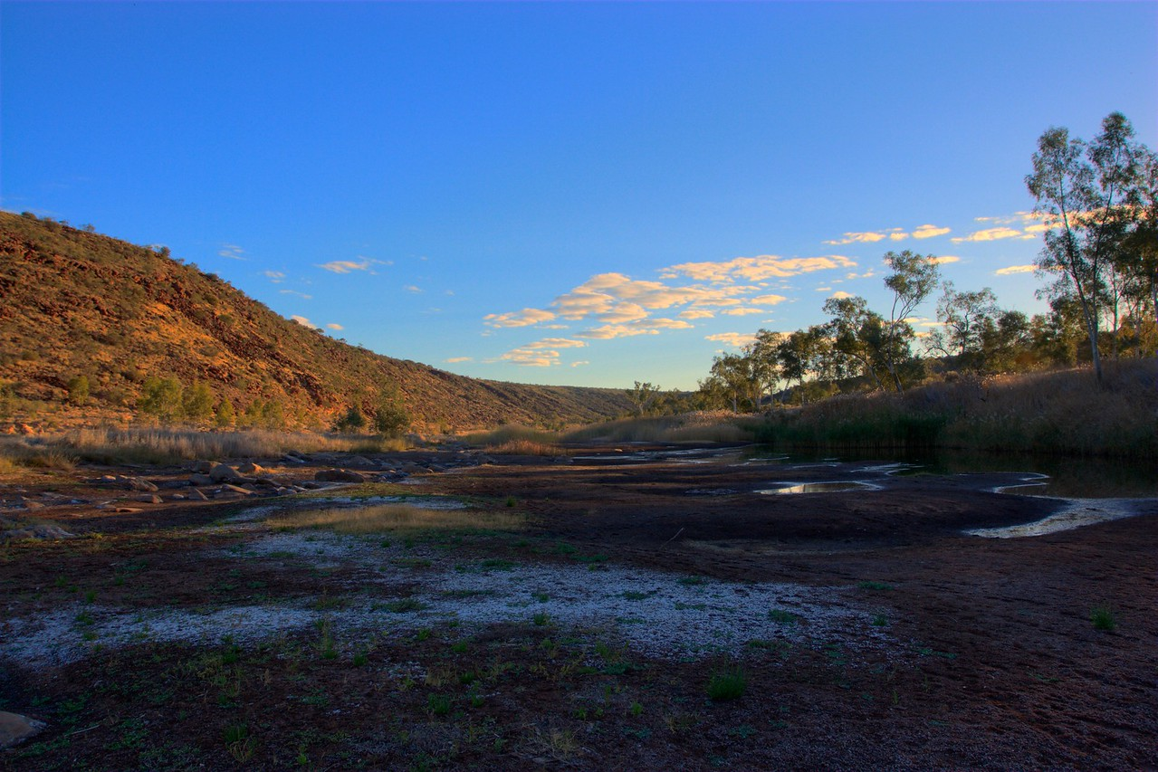Boggy Hole • The sun sets over the Finke River gorge, which is mostly dry apart from pools at Boggy Hole. The gorge floods perhaps twice a year, when the water reaches a depth of several metres.<br /> <br /> [Three different exposures blended together by Photomatix to produce a High Dynamic Range (HDR) image, which was then re-sampled as an 8- or 16-bit image.]