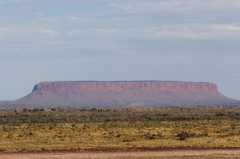 Mount Conner • Mount Conner, east of Ayers' Rock, as seen from the lookout along the Lasseter Highway in the Northern Territory. The mountain is easily confused with Ayers' Rock, and forms part of the same geological substrate.